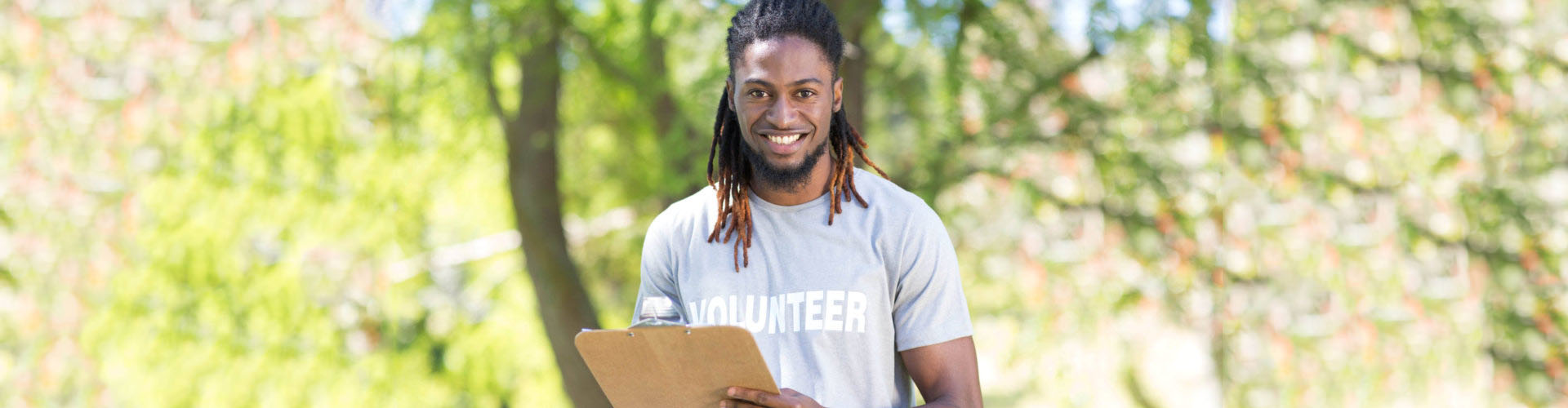young volunteer holding his clipboard